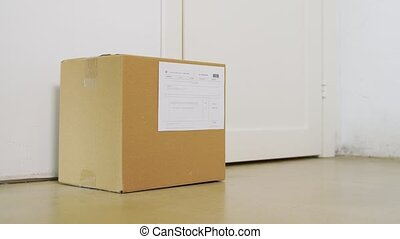 delivery girl in gloves leaving parcel box at door - health ...