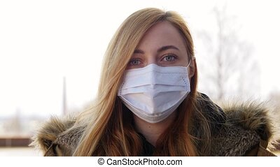 young woman wearing protective medical mask - health, safety...