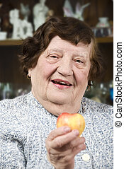 Health senior woman with fruit - Health senior woman sitting...