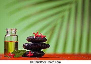 Health spa & massage still life of massage oil and balancing...
