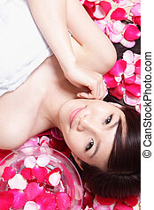 health spa woman Face with red rose