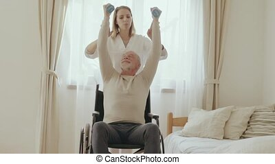 Health visitor and a senior man during home visit. - Health...