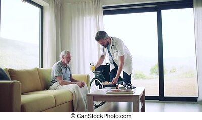 Health visitor bringing snack to a senior man in wheelchair during home visit. Slow motion.