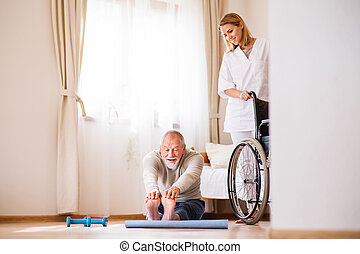 Health visitor and senior man during home visit.