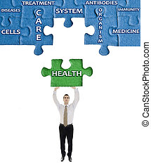 Health word on puzzle in man hands