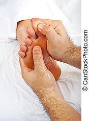 Health worker give reflexology massage