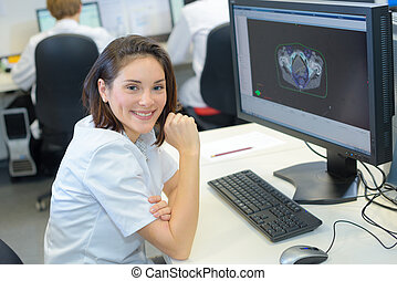 Health worker working on computer