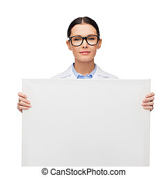female doctor in eyeglasses with white blank board -...