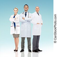 group of smiling doctors in white coats