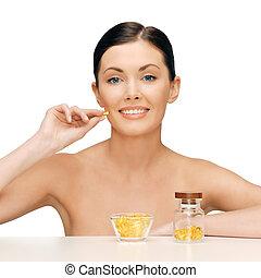 beautiful woman with omega 3 vitamins