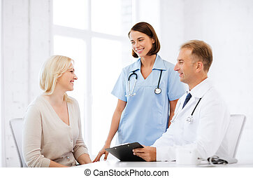doctor and nurse with patient in hospital - healthcare and ...