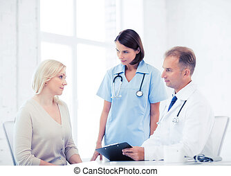 doctor and nurse with patient in hospital