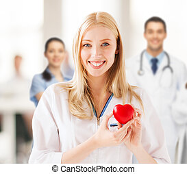 female doctor with heart - healthcare and medical concept - ...