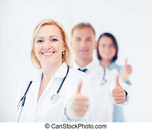 team of doctors showing thumbs up