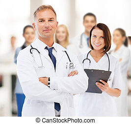 two doctors in hospital - healthcare and medical concept -...