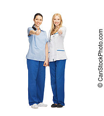 two doctors showing thumbs up