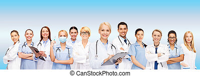 smiling female doctors and nurses with stethoscope -...