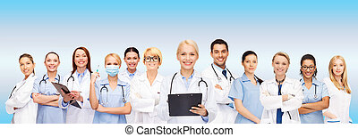 smiling female doctors and nurses with stethoscope