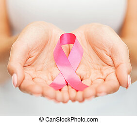 hands holding pink breast cancer awareness ribbon - ...