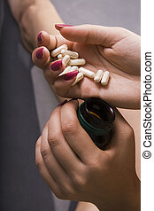 Healthcare and medicine: Young woman has control over pills.