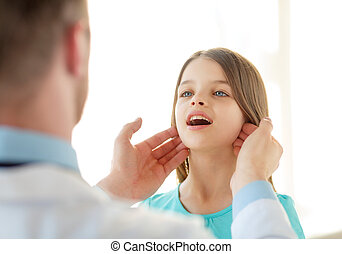 male doctor checks little girl lymph nodes - healthcare,...