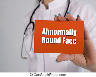 Healthcare concept about Abnormally Round Face with sign on the piece of paper.