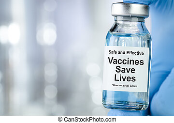 Healthcare concept with a hand in blue medical gloves holding a vaccine vial wtih the words Safe and Effective, Vaccines Save Lives, and does not cause autism
