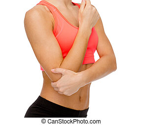 sporty woman with pain in elbow - healthcare, fitness and ...