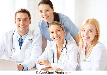 group of doctors with laptop computer - healthcare, medical ...