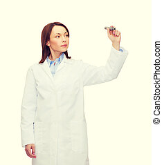 young female doctor writing something in the air