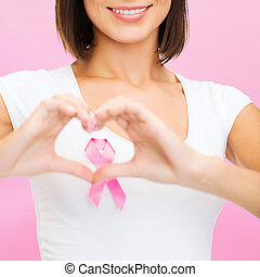 woman with pink cancer ribbon - healthcare, medicine and...