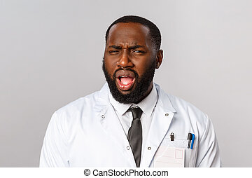 Healthcare, medicine and hospital treatment concept. What the hell are you talking about. Frustrated and displeased african-american doctor, therapist cringe, grimacing with disbelief at camera