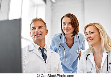 group of doctors with computer at hospital