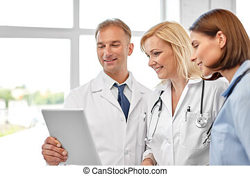 group of doctors with tablet computer at hospital