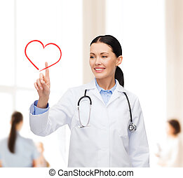 smiling female doctor pointing to heart