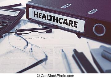 Healthcare on Ring Binder. Blured, Toned Image.