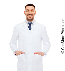 healthcare, profession and medicine concept - smiling male doctor in white coat over white background