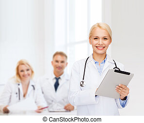 female doctor with stethoscope and tablet pc