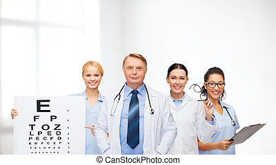 smiling eye doctors and nurses - healthcare, vision and...