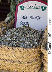 Healthcare, wicker baskets stuffed medicinal healing herbs