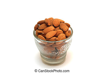 Healthful Almonds - Cupful of healthy, tasty, yellow-brown...