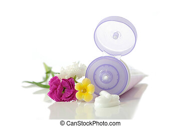 Tube of cream with flowers on a white background