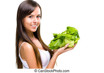 Healthful eating-Beautiful fit woman holding a salad.