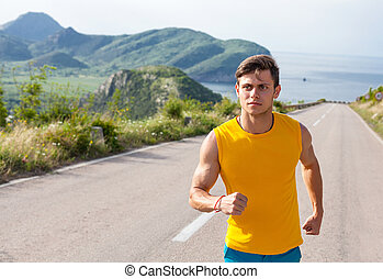Healthy active man runner running on the road