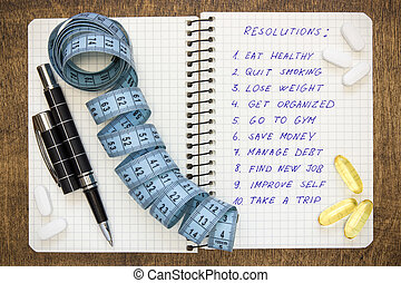 Healthy and ambitious resolutions - Resolutions written on a...