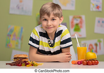 Healthy and unhealthy food - Boy choosing between healthy...