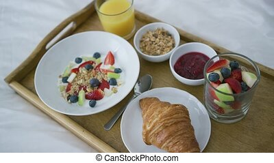 Healthy assorted breakfast served on tray - From above view...