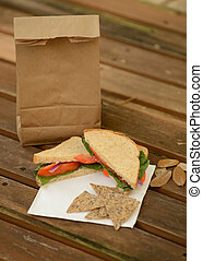healthy back to school lunch with veggie sandwich and brown...