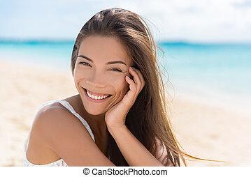 Healthy beautiful Asian multiracial woman on beach