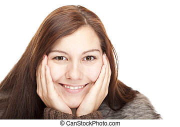 Healthy, beautiful, happy and relaxed woman looks into camera.